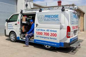 Precise Plumbing van and plumber, delivering a water heater