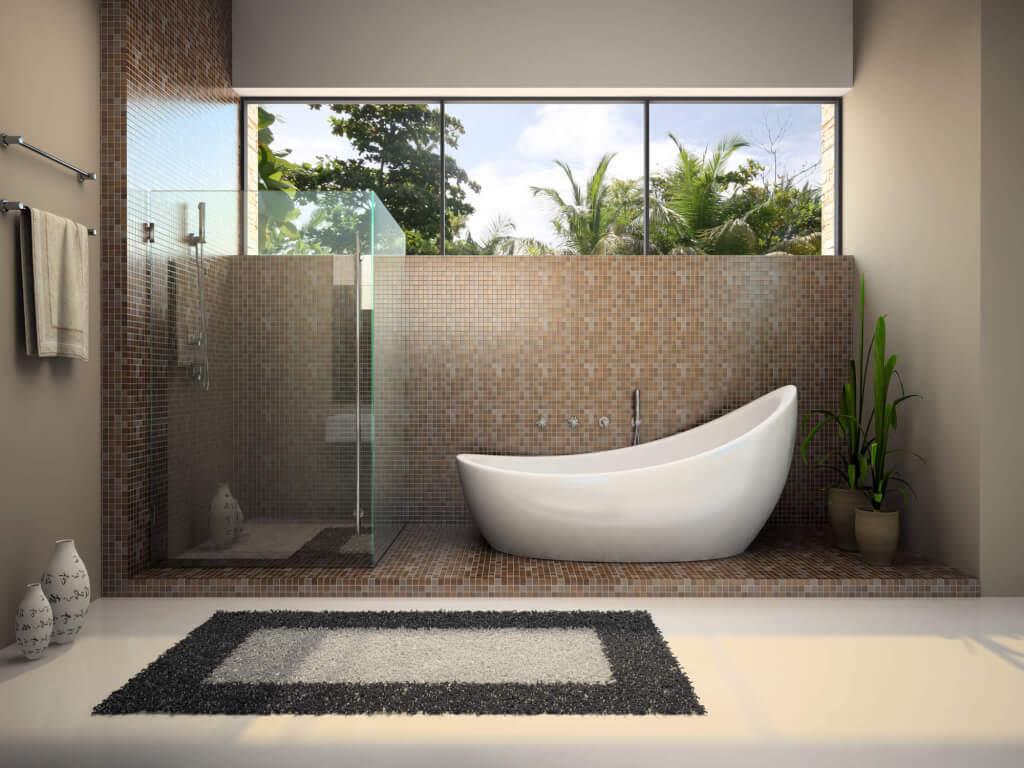 Modern Bathroom renovation featuring a freestanding bath, frameless shower, and tiling detail
