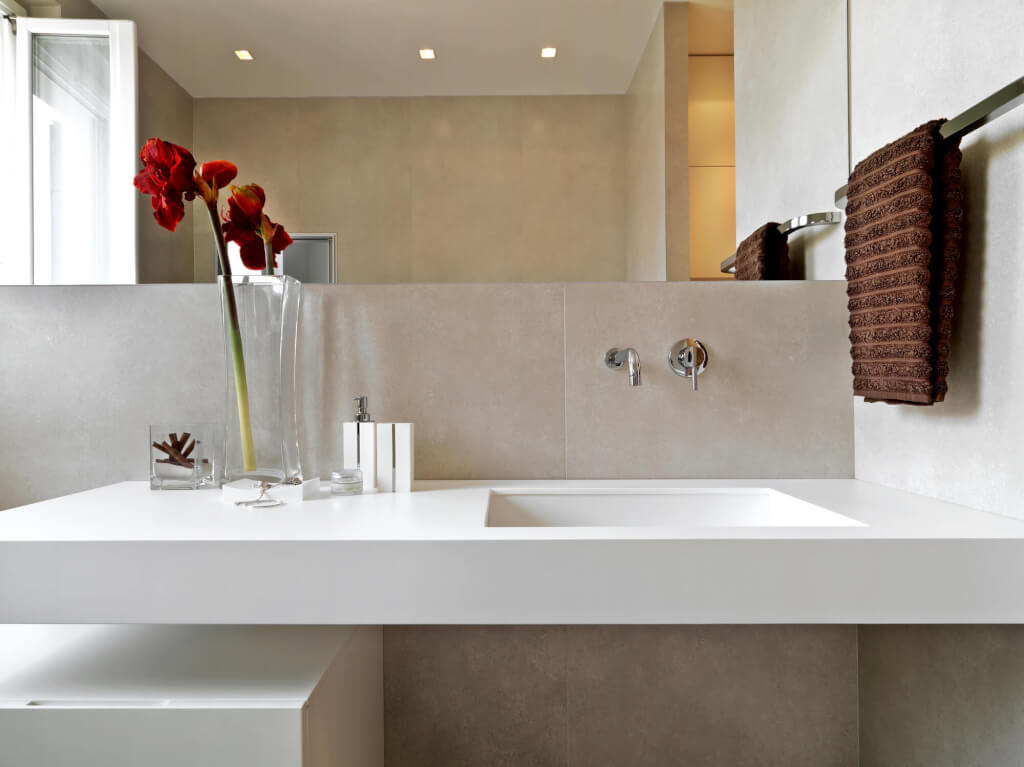 Detail of a floating wall mounted bathroom benchtop installed without cabinetry