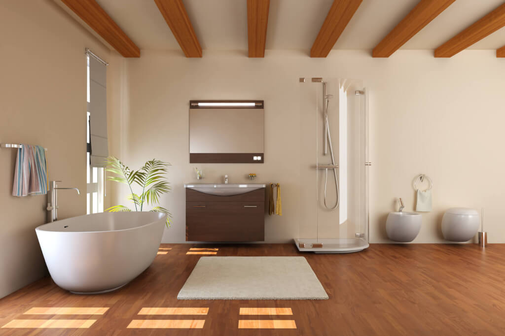 Modern bathroom renovation featuring wall mounted vanity, frameless shower, and freestanding bathtub