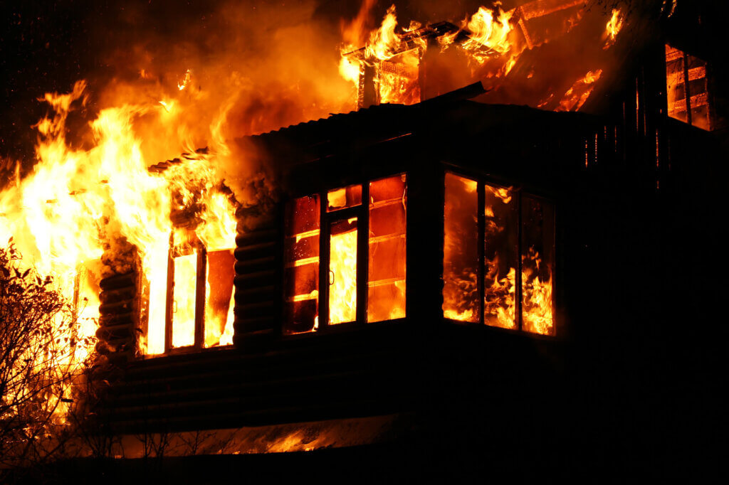 Picture of a house engulfed by fire